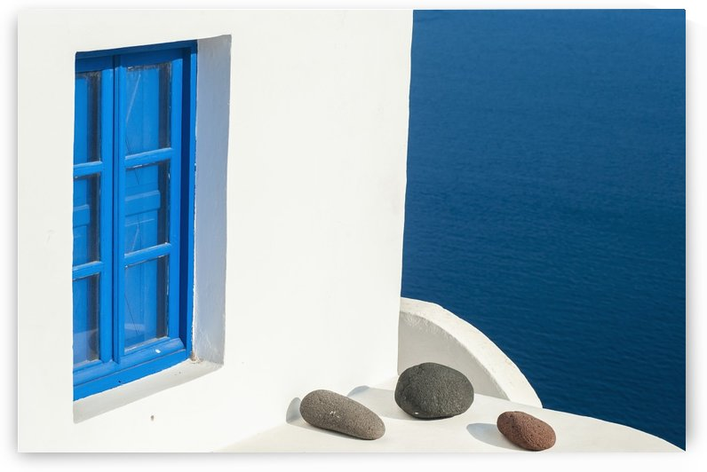 Whitewash building with blue trimmed window along the Aegean sea; Oia, Santorini, Greece by PacificStock
