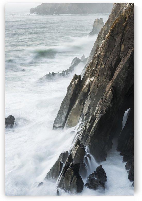 Surf breaks on the rocks; Manzanita, Oregon, United States of America by PacificStock