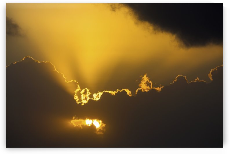 Close up of the sun coming through clouds with rays beaming up at sunrise; Akumal, Quintana Roo, Mexico by PacificStock