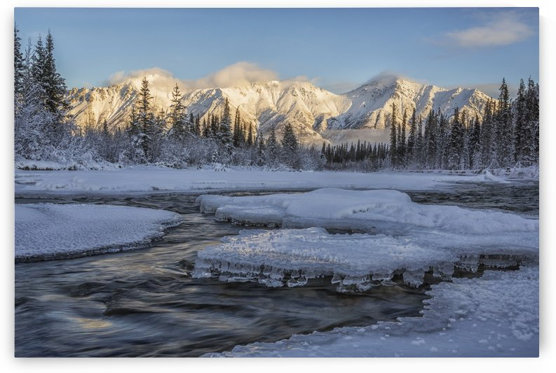 Sunset over the Wheaton River as the light hits Grey Ridge, near Whitehorse; Yukon, Canada by PacificStock