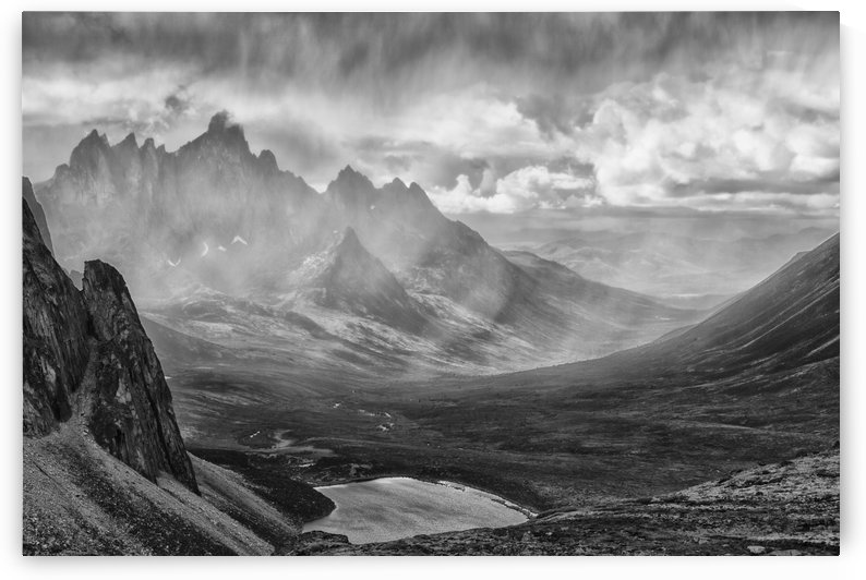 Black and White image of a rain storm over the Tombstone Valley in Tombstone Territorial Park, with Tombstone Mountain shrouded in the rain in the distance; Yukon, Canada by PacificStock