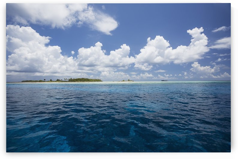 Atoll with ship in the distance; Tahiti by PacificStock