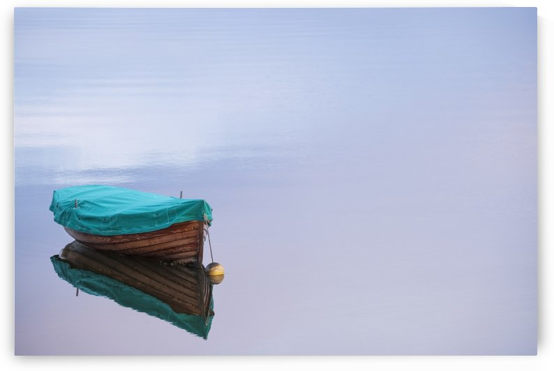 Boat reflections on the still calm water; County Mayo, Ireland by PacificStock