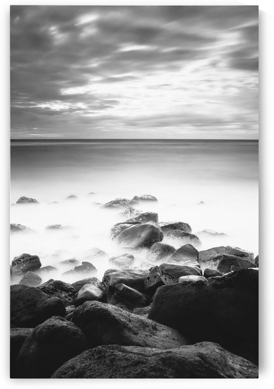 Long exposure of the surf along Wailua Beach processed in high contrast black and white; Wailua, Kauai, Hawaii, United States of America by PacificStock