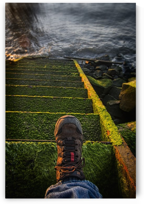 An old stairway on the Astoria riverfront that leads into the water; Astoria, Oregon, United States of America by PacificStock