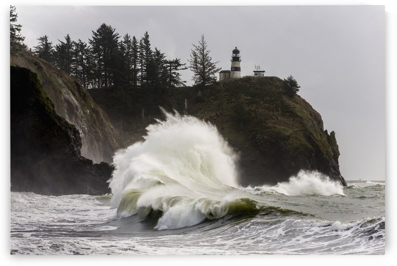 Surf breaks at Cape Disappointment Lighthouse; Ilwaco, Washington, United States of America by PacificStock