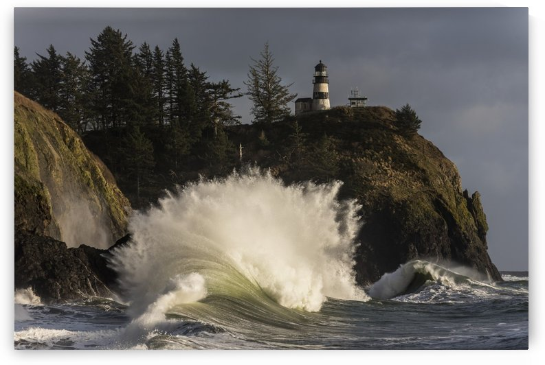 A wave explodes at Cape Disappointment; Ilwaco, Washington, United States of America by PacificStock