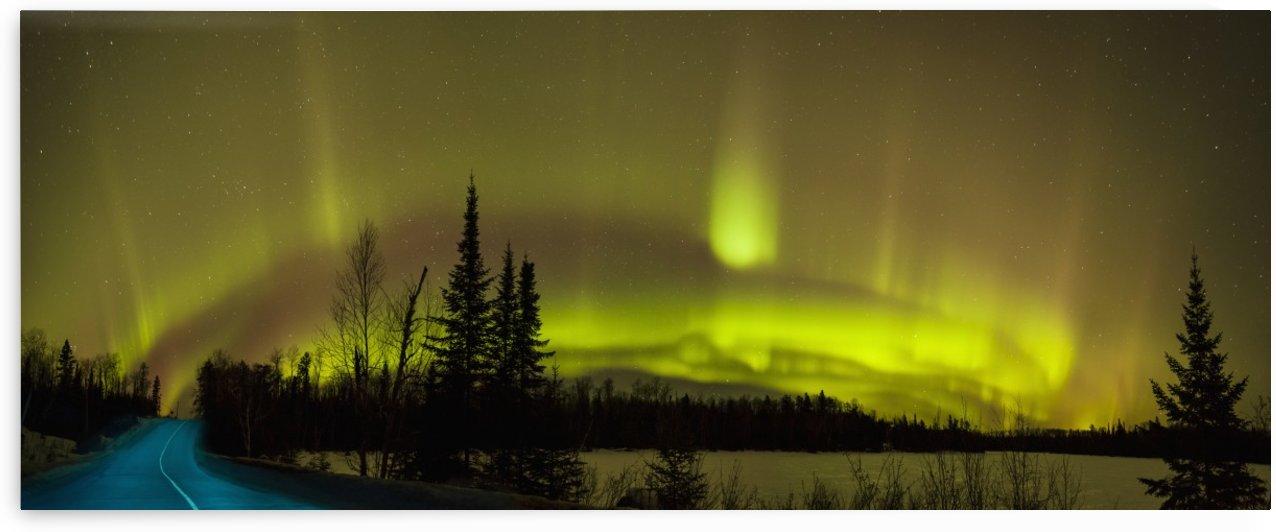 Aurora borealis over the road; Thunder Bay, Ontario, Canada by PacificStock