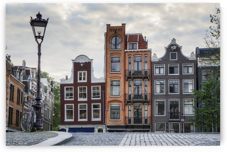 Unique residential buildings and a lamp post; Amsterdam, Netherlands by PacificStock