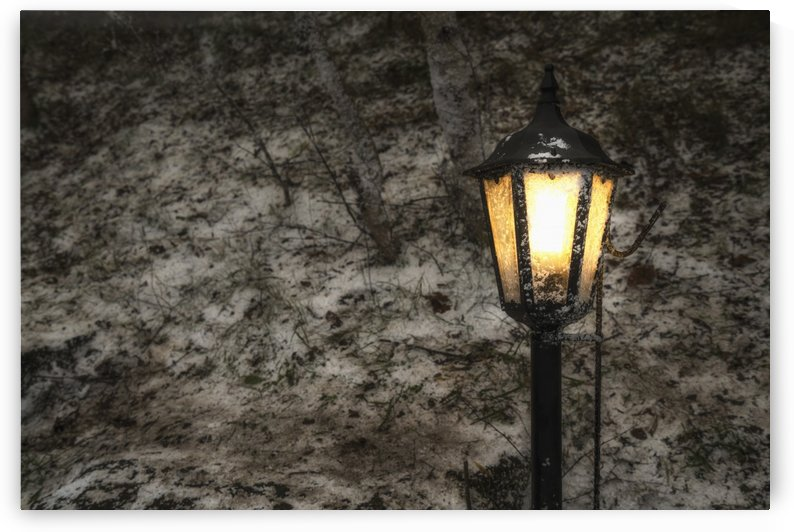 Illuminated lamp post against a stone wall; Beamish, England by PacificStock