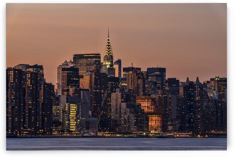 Midtown Manhattan skyline at sunset; New York City, New York, United States of America by PacificStock