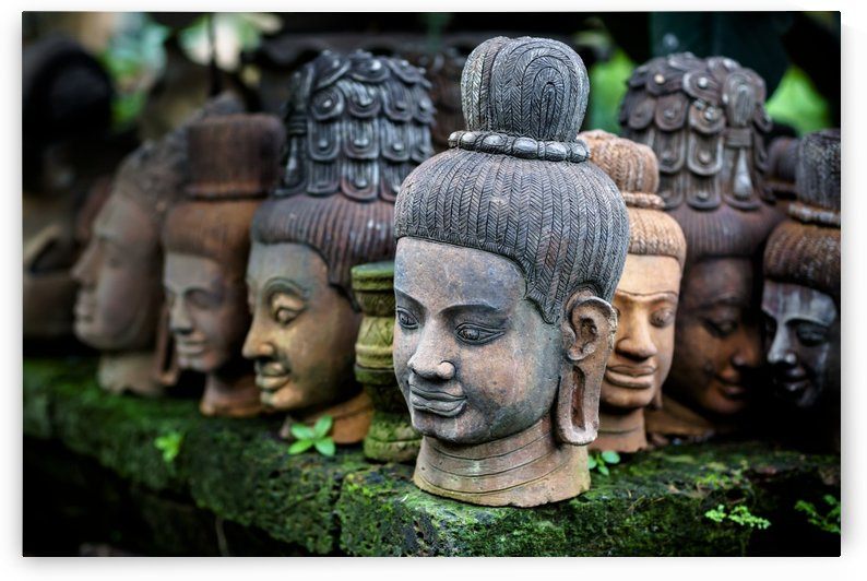 Heads of statues of Buddha are stacked in a terra-cotta factory; Chiang Mai, Thailand by PacificStock