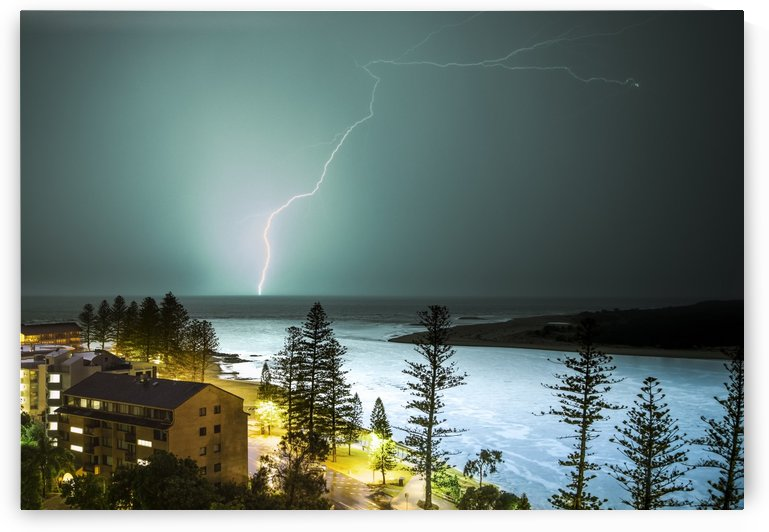 A lightning strike hits the surface of the water in the distance; Brisbane, Queensland, Australia by PacificStock
