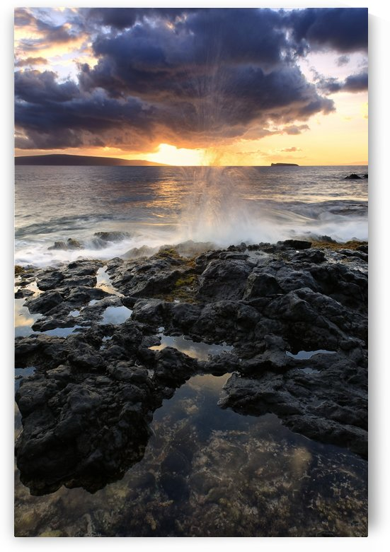 Water splashing onto the lava rock along the coast at sunset; Hawaii, United States of America by PacificStock