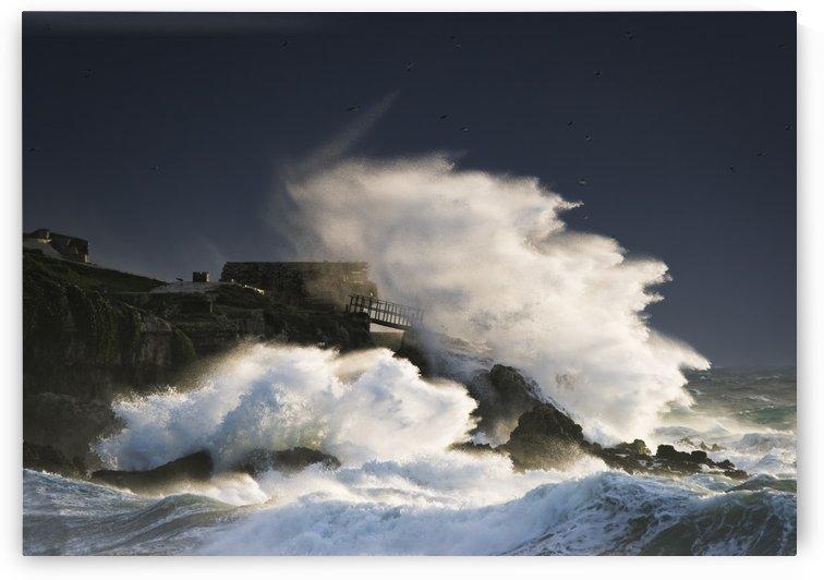 Wave crashing into shore and splashing onto the land above the cliffs, Isla de la Palomas; Tarifa, Cadiz, Andalusia, Spain by PacificStock