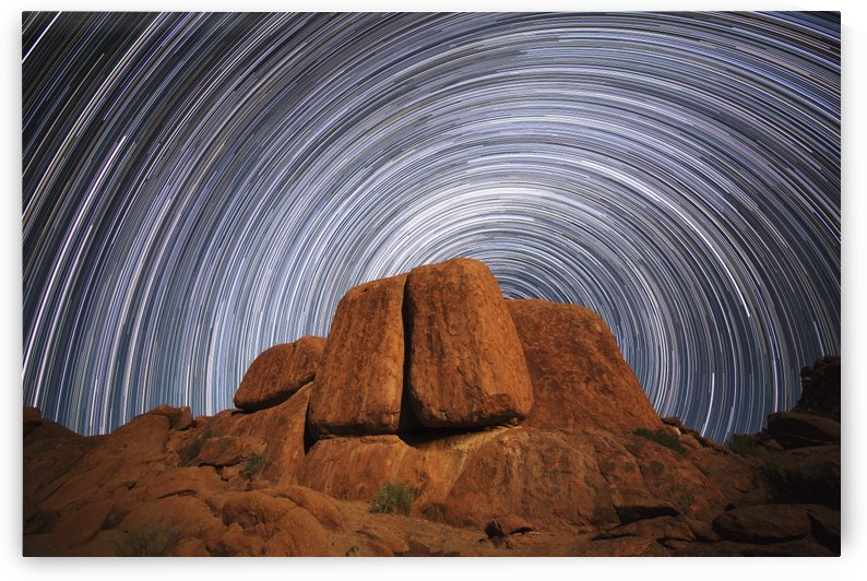 Star trails above a large boulder in Richtersveld National Park; South Africa by PacificStock