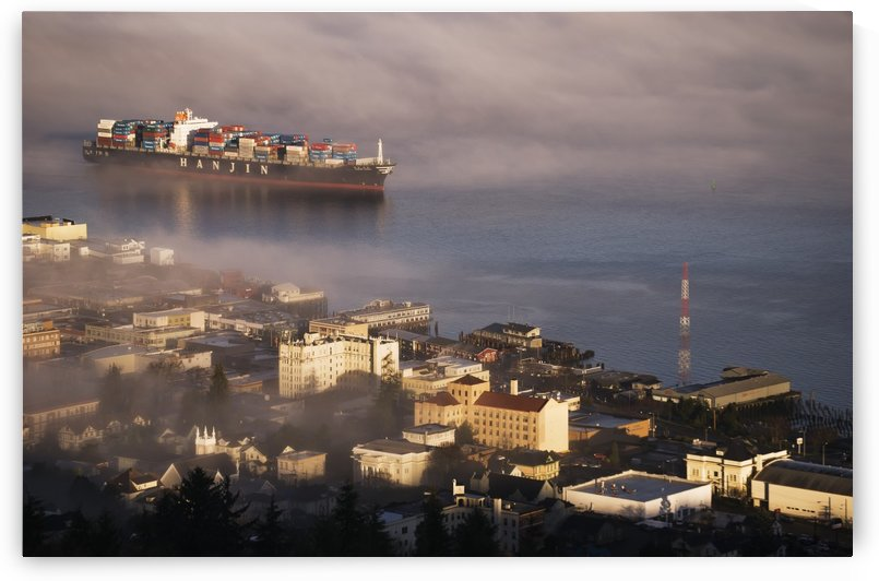 A container ship emerges from the fog; Astoria, Oregon, United States of America by PacificStock