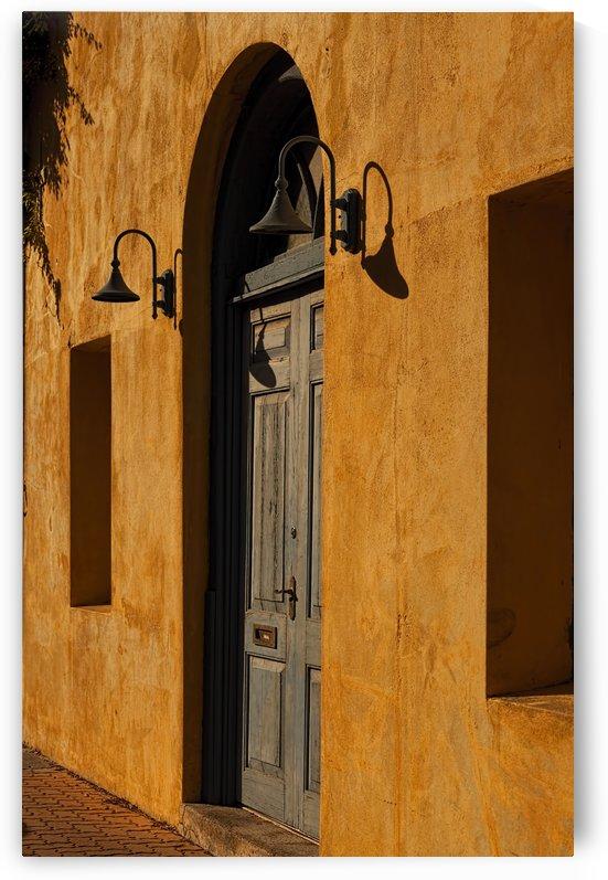 Blue Door in a Orange Wall by Maxwell Jordan
