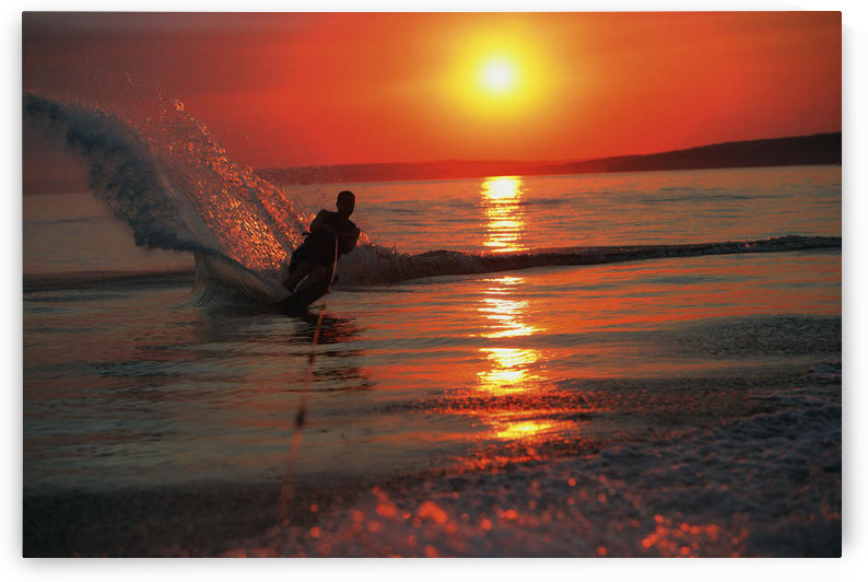 Waterskiing At Sunset by PacificStock