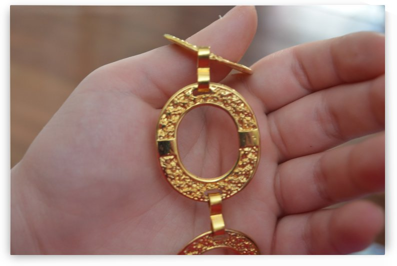 Golden necklace by Cassandra Lewis