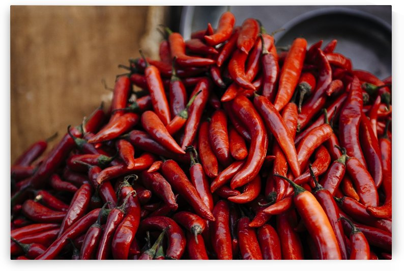 Red Peppers in the Market of Cairo by Raisa Mirza