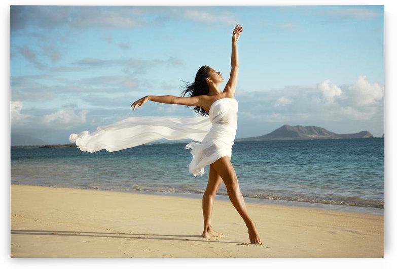 Hawaii, Oahu, Lanikai Beach, Beautiful Female Ballet Dancer On Beach Wearing White Flowing Fabric. by PacificStock