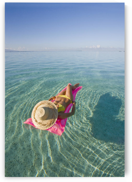 French Polynesia, Tahiti, Moorea, Woman Floating In Water. by PacificStock