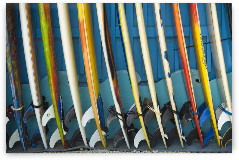 Row Of Surfboards Lined Up Against A Wall. by PacificStock