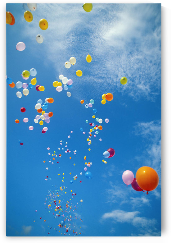Hawaii, Colorful Balloons Float In The Air Against A Blue Sky With White Clouds by PacificStock