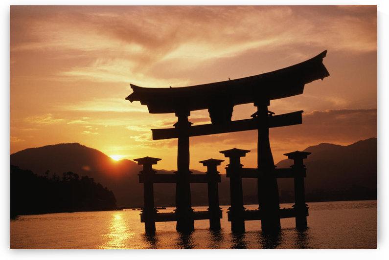 Japan, Kyushu, Miyajima Torii Gate In Water, Itsukushima Shrine, Peaceful Sunrise by PacificStock