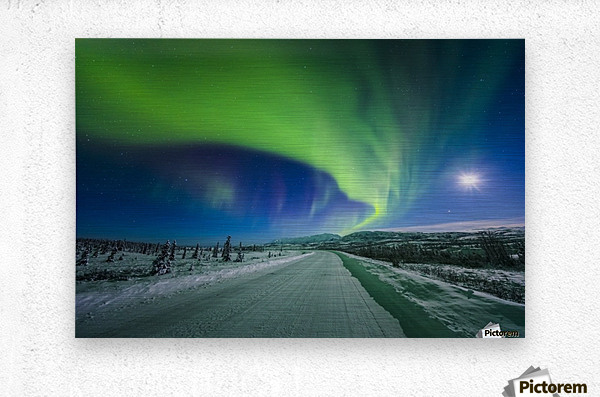 The moon and aurora shine in the night sky over a snow covered Richardson Highway south of Delta Junction; Alaska, United States of America  Metal print