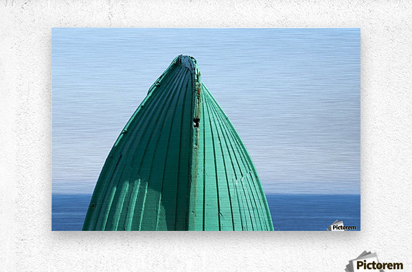 Close-up of  the bottom of the bow of a wooden boat painted green and the tranquil water and blue sky in the background; South Shields, Tyne and Wear, England  Metal print