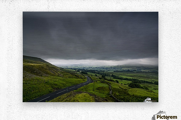Dark storm clouds over a lush, green landscape and road; North Yorkshire, England  Metal print