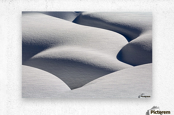 Artistic montage of snow contouring a creek bed with graphic designs of curving highlights and shadows; Lake Louise, Alberta, Canada  Metal print