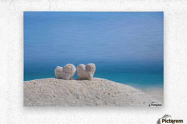 Two white heart shaped coral rocks placed together on sand at the beach; Honolulu, Oahu, Hawaii, United States of America  Metal print