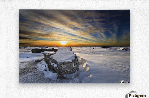 A large ice block on frozen Turnagain Arm at sunset; Anchorage, Alaska, United States of America  Metal print