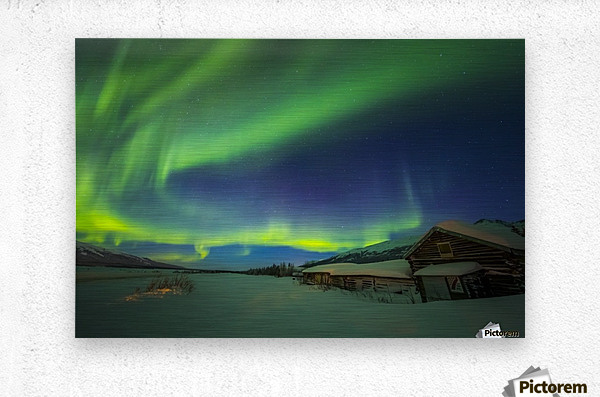 The aurora fills the sky above the historic Black Rapids Roadhouse along the Richardson Highway on a bitterly cold night; Alaska, United States of America  Metal print