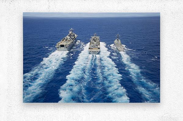 USS Peleliu and USS Spruance conduct a replenishment at sea with USNS Rainier.  Metal print
