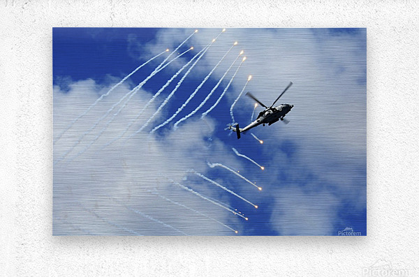 An HH-60H Sea Hawk helicopter releases countermeasure flares.  Metal print