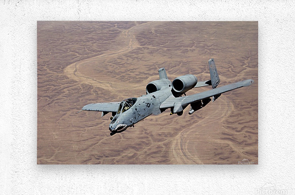 An A-10 Thunderbolt soars above the skies of Iraq.  Metal print