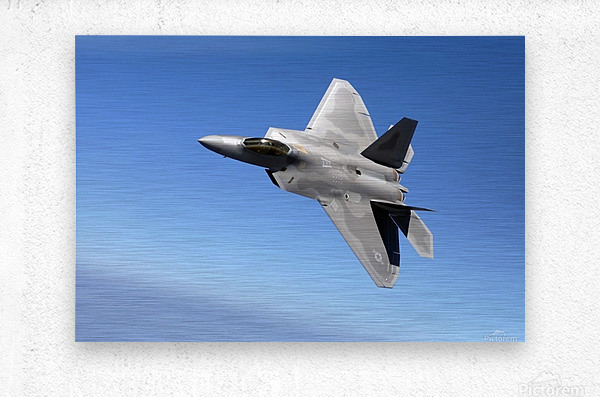 An F-A-22 Raptor banks during a training sortie.  Metal print