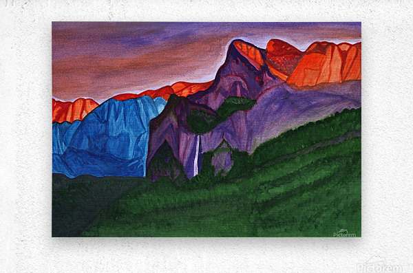 Snowy peaks of the mountains with a waterfall lit up by the orange dawn  Metal print