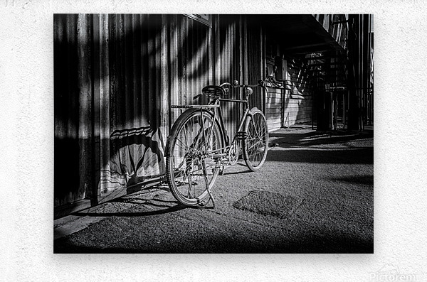 Bicycle parked against the building black and white  Metal print