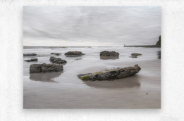 Rocks on a sandy beach  Metal print