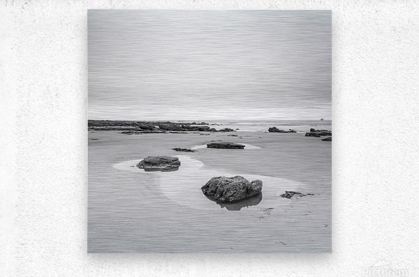 Rock pools on a sandy beach  Metal print