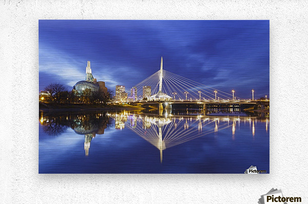 Canadian Museum for Human Rights and Esplanade Riel bridge reflected in the Red River; Winnipeg, Manitoba, Canada  Metal print