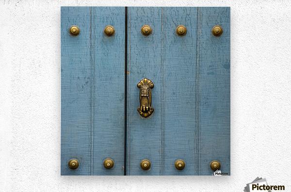 A Blue Door With Brass Decorative Knobs; Cusco, Peru  Metal print