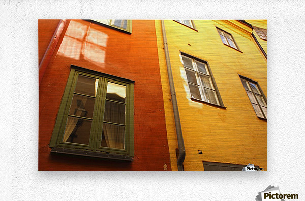 Low Angle View Of Red And Yellow Painted Buildings; Stockholm, Sweden  Metal print