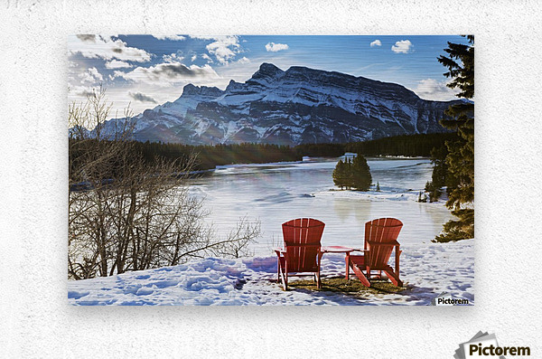 Two red chairs on snow covered ridge overlooking frozen lake with snow covered mountain in the background with blue sky and clouds; Banff, Alberta, Canada  Metal print