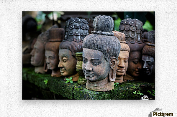 Heads of statues of Buddha are stacked in a terra-cotta factory; Chiang Mai, Thailand  Metal print